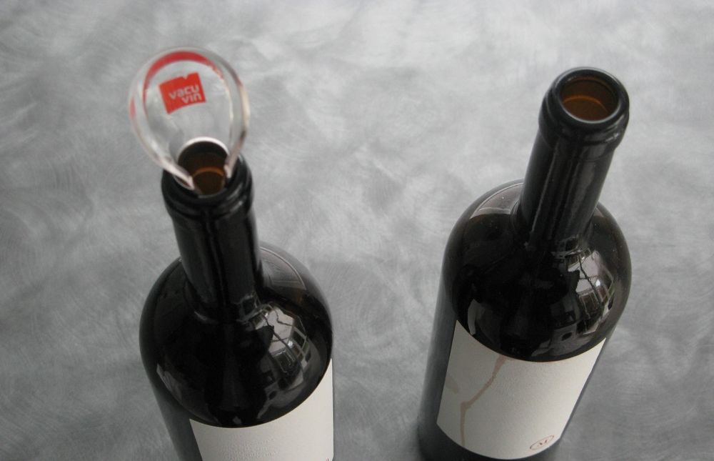 Vacu Vin's Wine Server Crystal is tested on a bottle with a pure white label