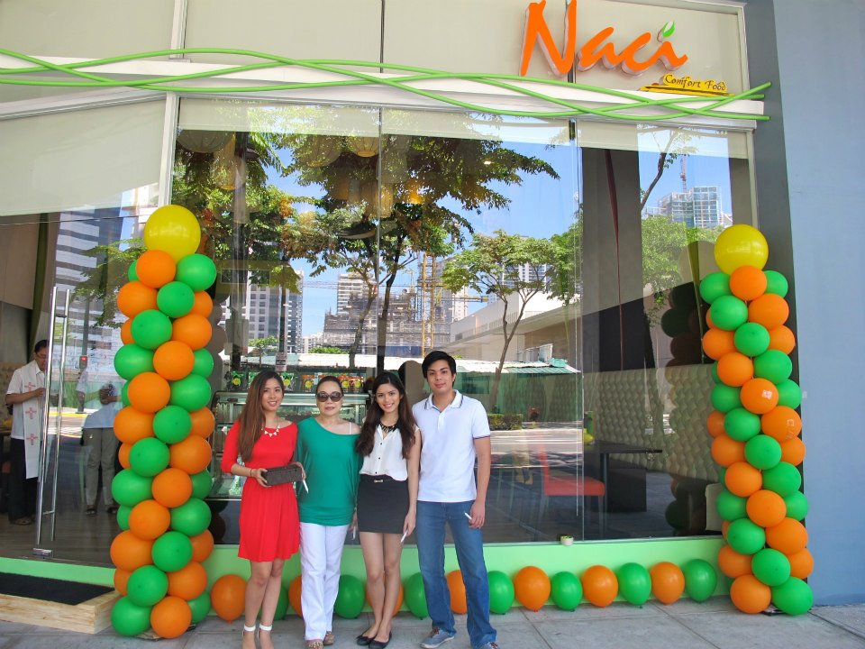 Natasha and her family in front of Naci Comfort Foods, her restaurant in Bonifacio Global City
