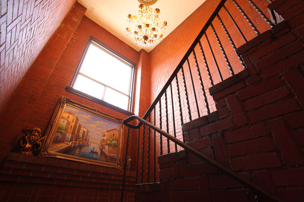 Located upstairs at Voila Spa Salon and Perfumerie, follow the brick staircase and chandeliers upwards towards Kai Med Spa.