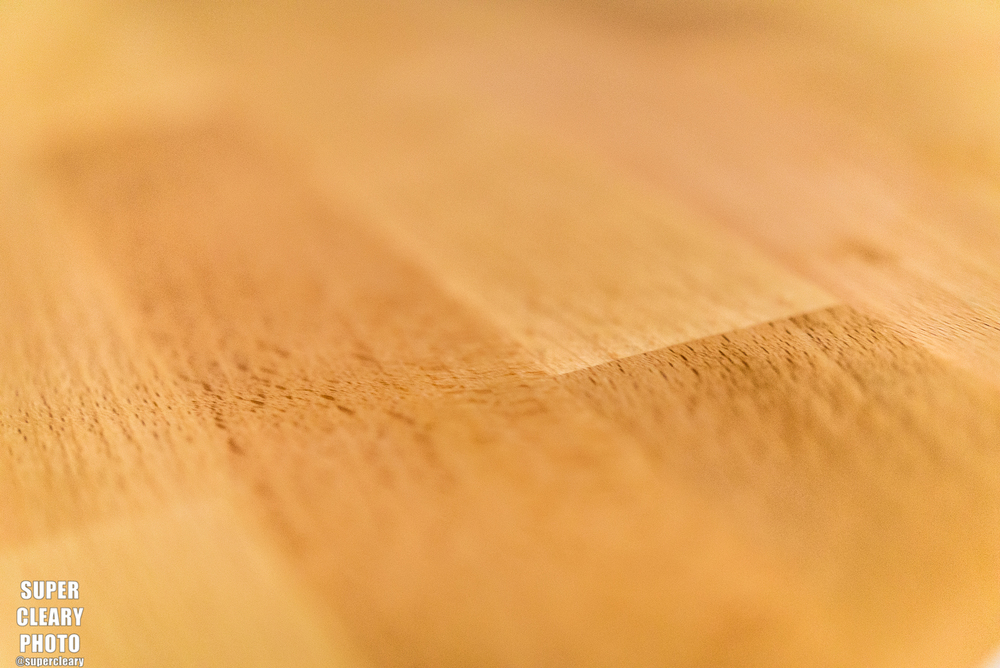 The work surface material is a hearty wood with a nice sand on it.