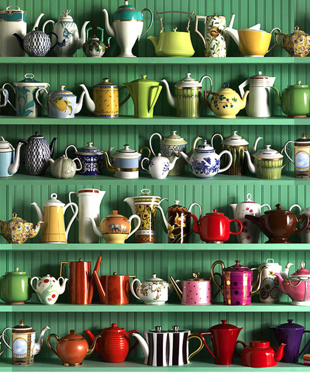 Collection of tea pots looking  mighty good with this green background