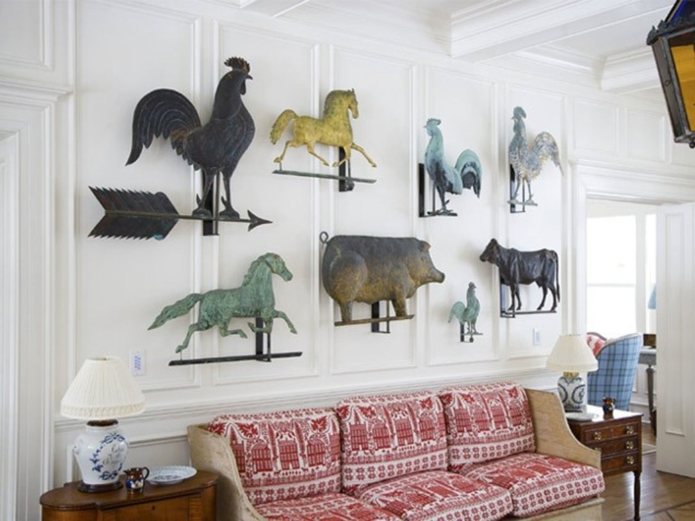 Collection of antique animal-shaped weathervanes on display in a living room