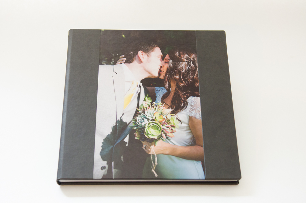 The large 12 x 12 album is leather bound, and features a photo laid into the front cover.