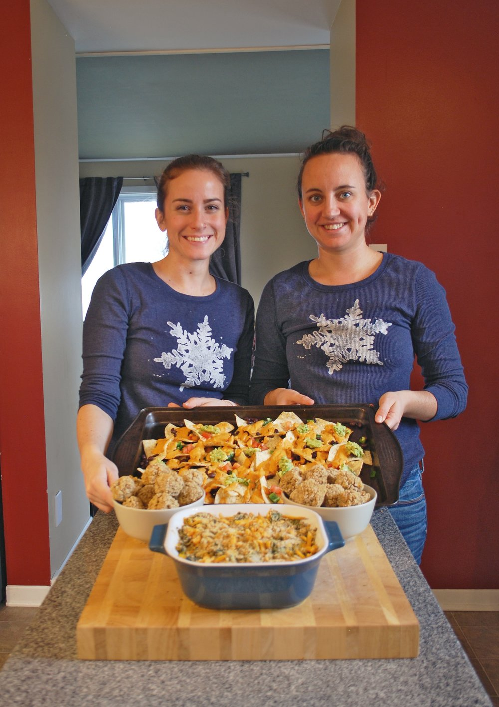 Anna and Jamie with vegan dishes