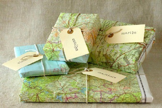 "Old maps make extremely ""smart"", eco-friendly wrapping paper.  Expand on this idea and use anything interesting like old blueprints or sheet music, or even stunning magazine pages."