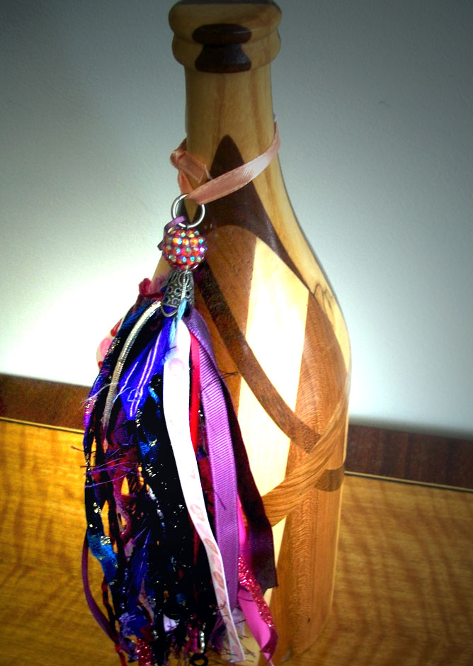 At the gallery, we have artful tassels that can really elevate a gift, such as a bottle of wine.
