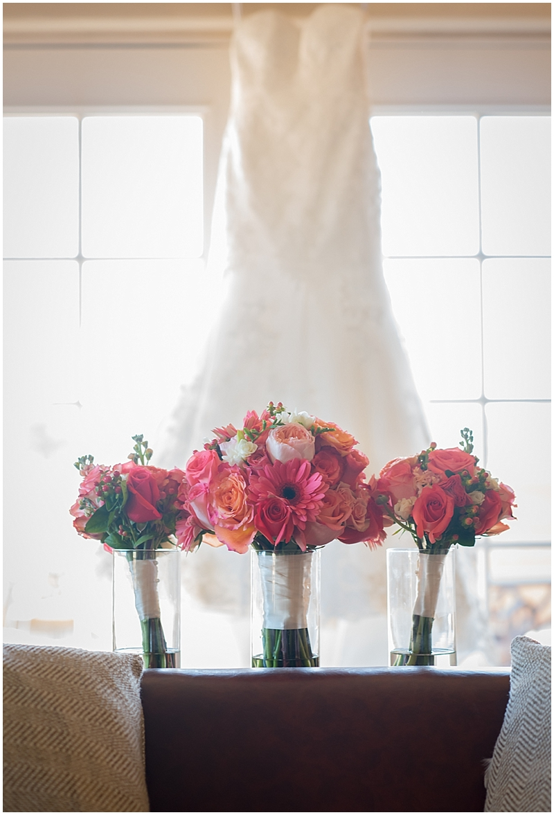 I love these bouquets from Posh Petals placed in front of Shannon's wedding dress