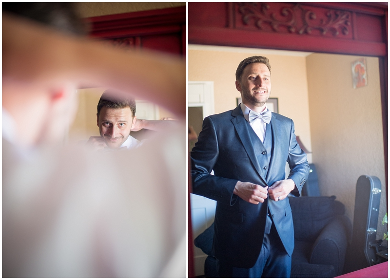 groom-getting-ready-in-mirror.jpg