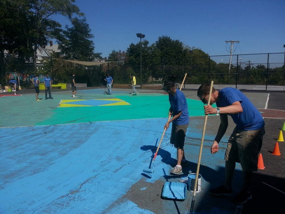 Teams from Constant Contact and Ernst & Young work on outdoor play areas at the Arthur Healy School in Somerville