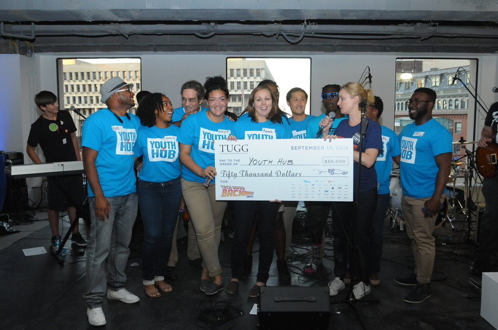 Team Youth Hub accepts their $50k grant win in the New Organization category