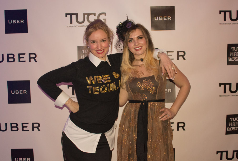 At TUGG Makes Boston, the 11th Annual Wine & Tequila Party, in front of the Uber wall, a partnership established by Elizabeth