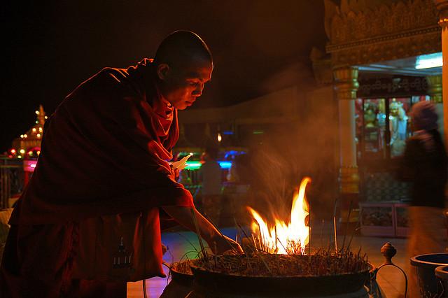monk burning incense.jpg