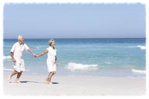 retired couple on beach homepage.jpg