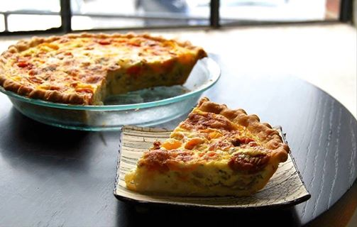 tomato, onion, basil, and gruyere cheese pie