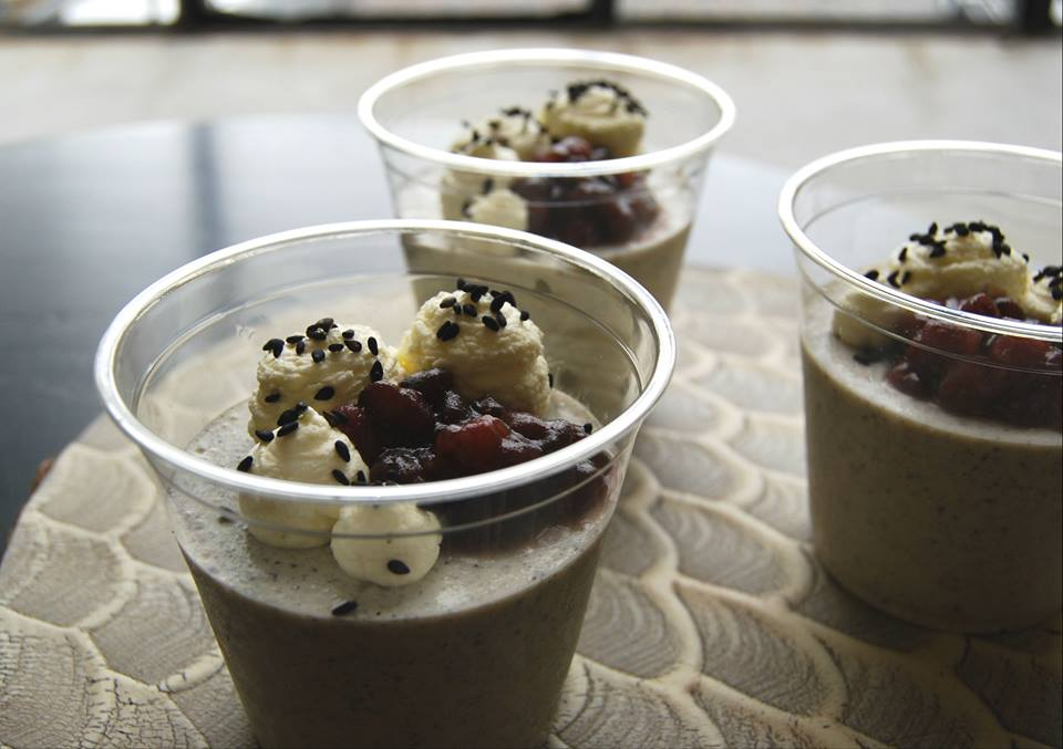 black sesame pannacotta with sweet red beans and whipped cream