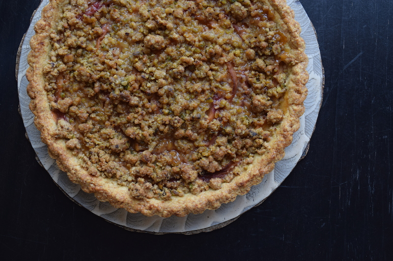peach tart with pistachio crumble