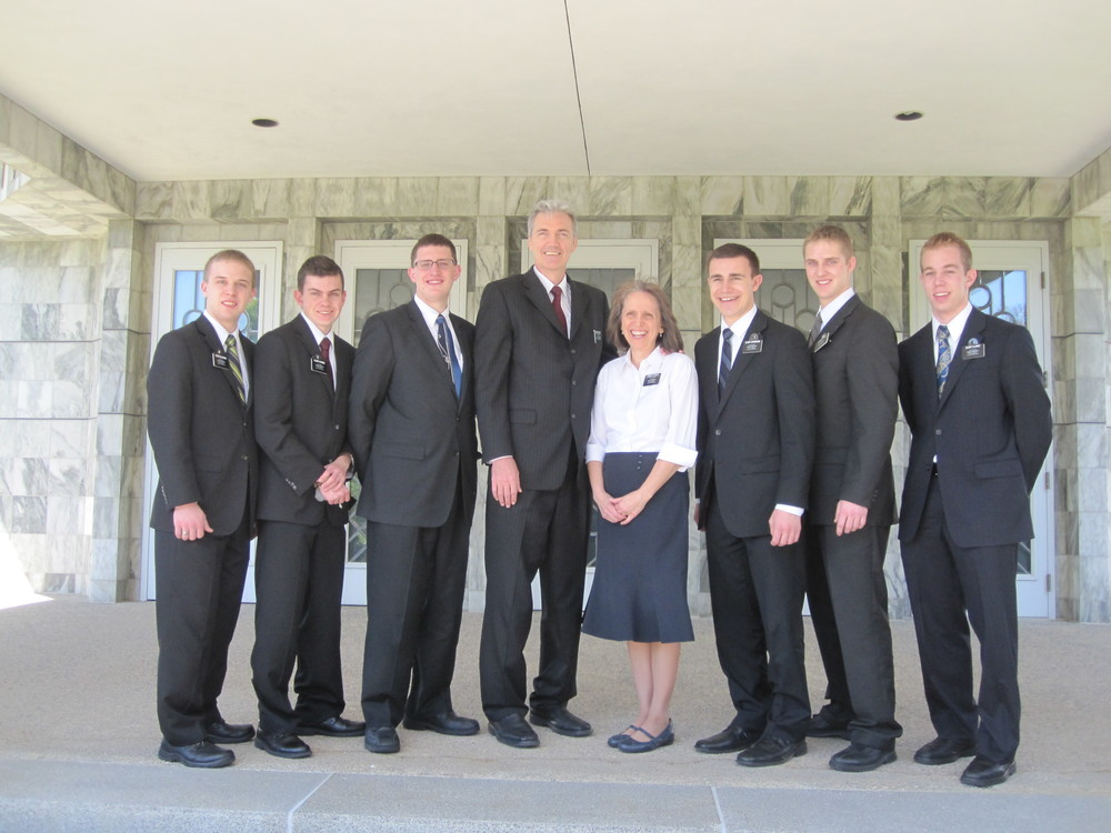 "President & Sister Durrant of the Dallas Mission with Elder Blanding (far left) and five other ""visa waiters""."
