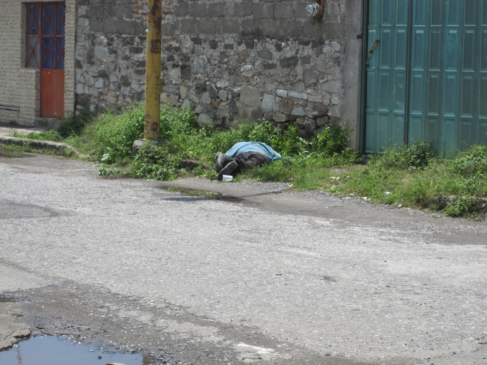 Mexican drunk passed out on the street.