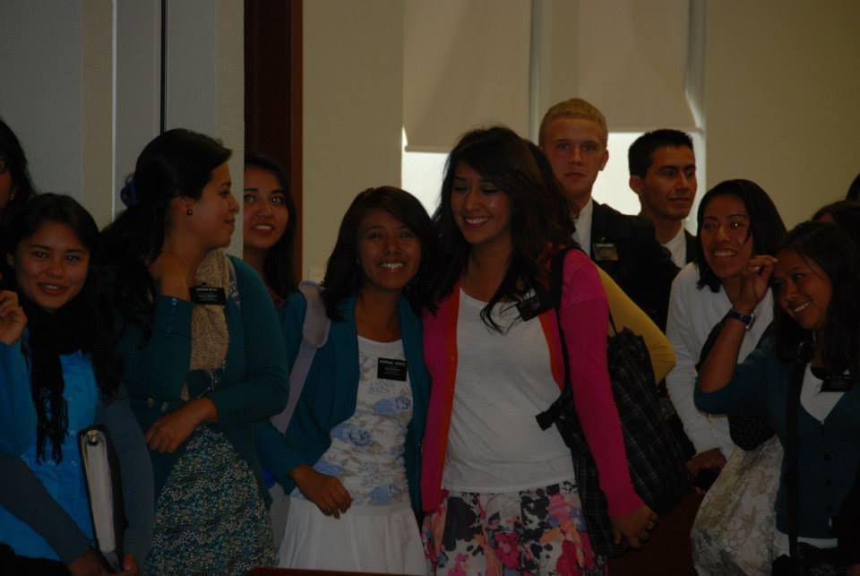 Elder Blanding peeking around on the right of the sister missionary. He's the blond.