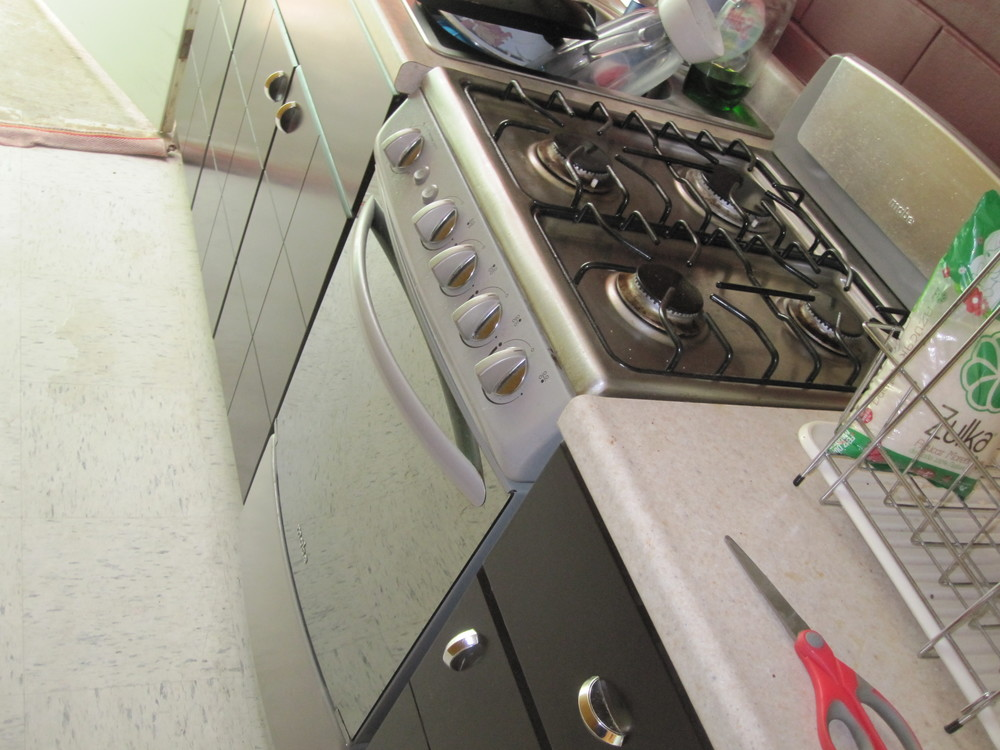 Elder Jason Blanding's apartment: HE HAS A STOVE!