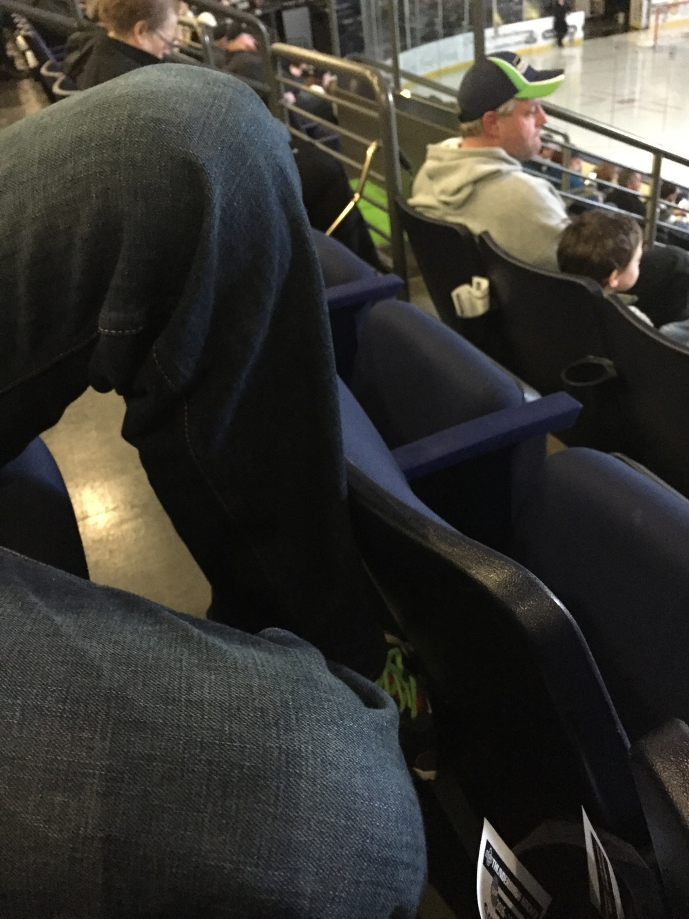 Chris's poor legs. No room at the hockey game for six foot boys and their long legs!