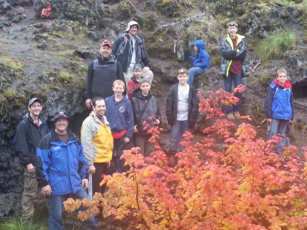 Chris is on the right in the black coat with yellow around his neck. Oct 2012