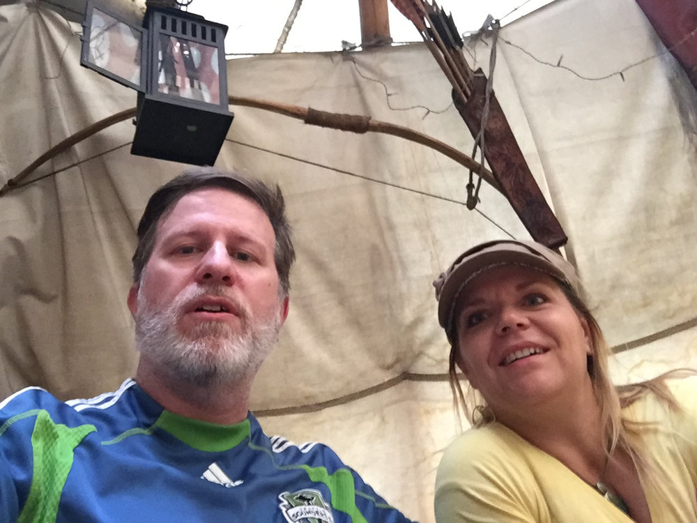 Steve and Doreen eating in a Tipi