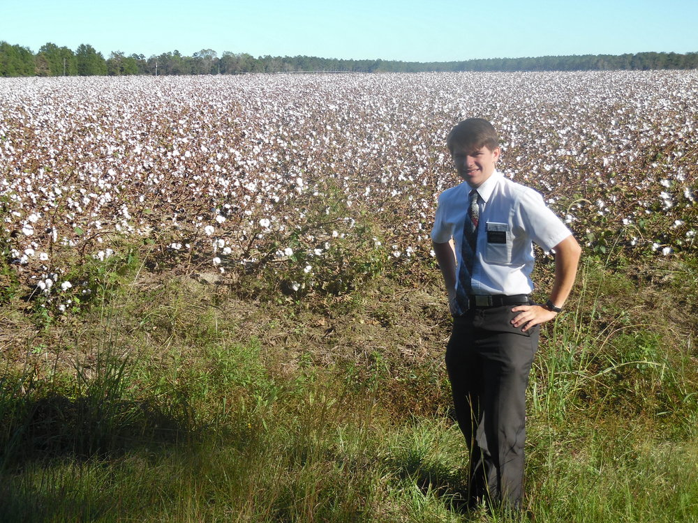 """Elder Blanding in a cotton field. He said he was getting bit by bugs in this photo. """"The field is white..."""""""