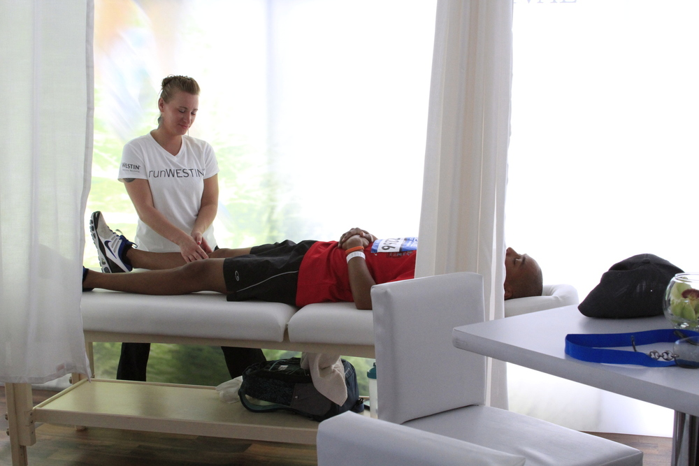 A massage therapist is on-site to help runners relax their tense and tired muscles.