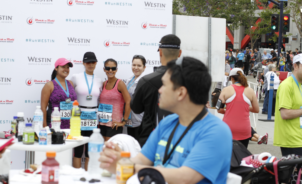 A prominent Step & Repeat gave runners a place to take photos celebrating their accomplishment.