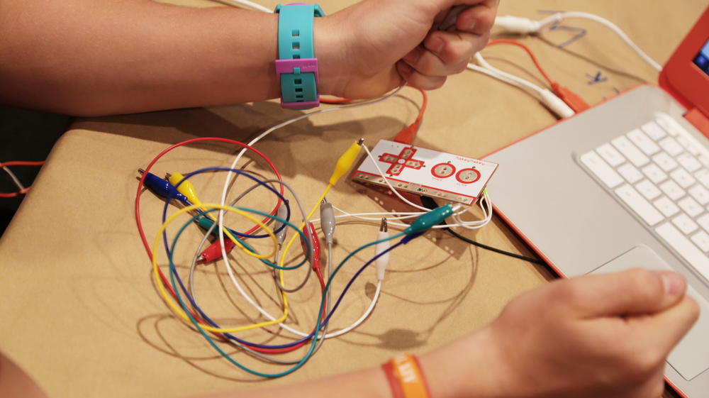 Students were divided into groups of two and invited to experiment with the technology. The Music Stations was introduced to MakeyMakey, a circuit board you plug into your computer that allows you to (among many other things) turn common objects like bananas, into musical instruments.