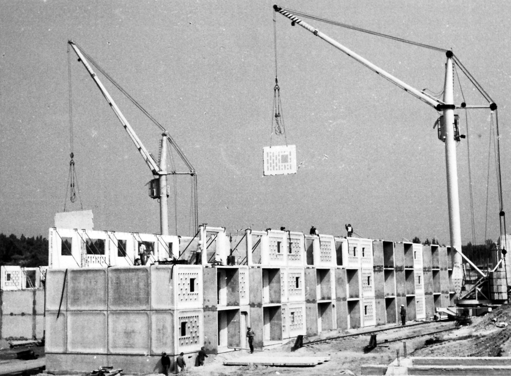 A crane hoists a concrete panel in place, from a Chilean construction site in the 1970s. Courtesy Hatje Cantz