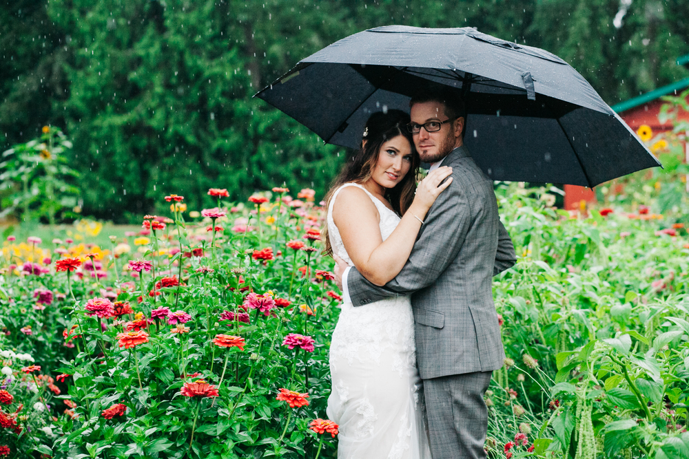 Full on downpour in the middle of the day for this August wedding out at Farm Kitchen in Poulsbo, WA.