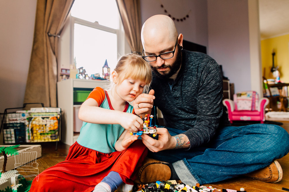 Father-Daughter Lego Building Session. I love her little chin on his hand.