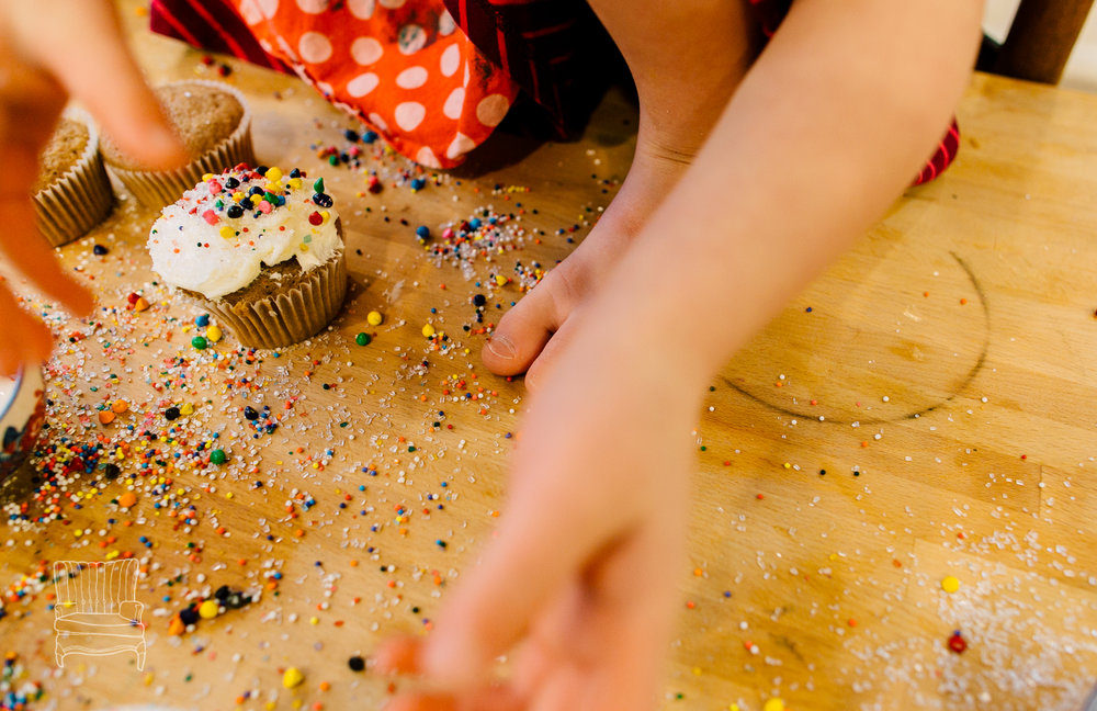 This was one of my favorite shots from this mother-daughter baking session. She loved being up on the table and using as many sprinkles as she could.