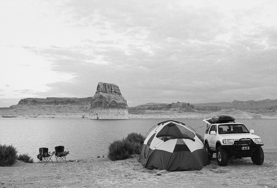 ^ After a day that started with breaking camp in a downpour, then the following monsoon enduring drive, we finally arrived back to Lone Rock Beach at Lake Powell. We pulled the rig right up to the sandy shoreline and pitched camp in the blissfully dry desert air which quickly dried out all of our soaked gear.
