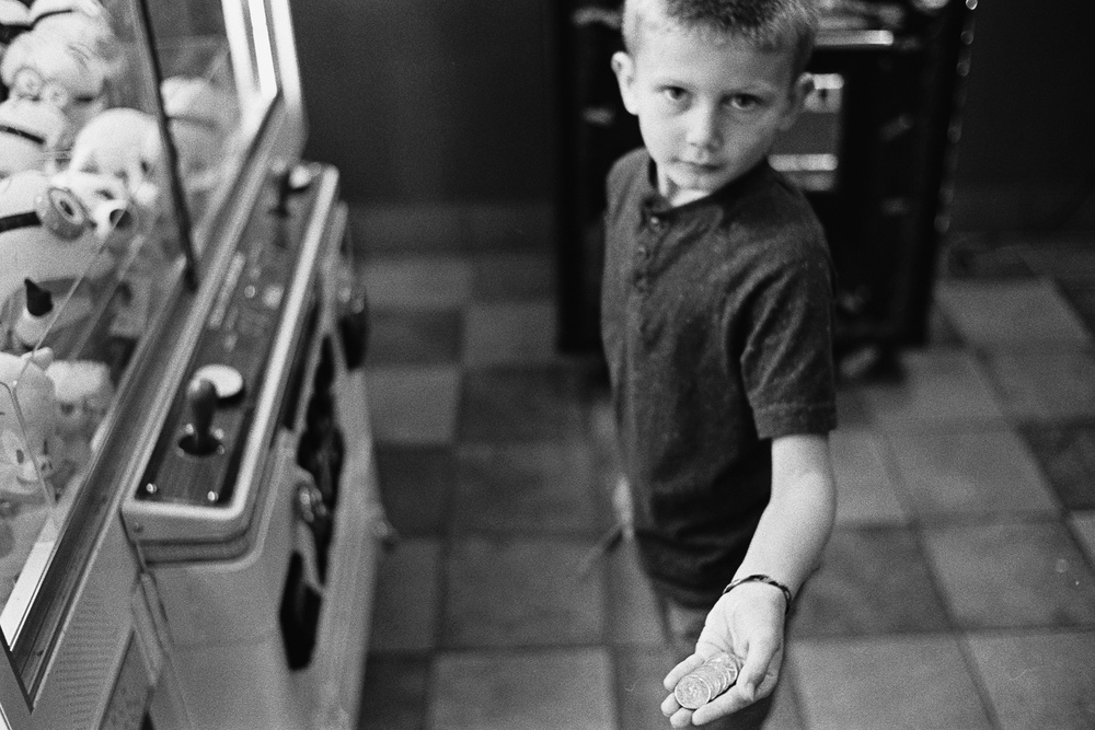 ^ Jasper is a master of finding change. Every place we go he is on all fours digging around under counters and displays looking for change. He also learned this trick that if you put a knife in the coin slot of a video game machine you can jiggle loose any stuck change. Here he demonstrates the technique in a truck stop. This particular machine netted him $3!
