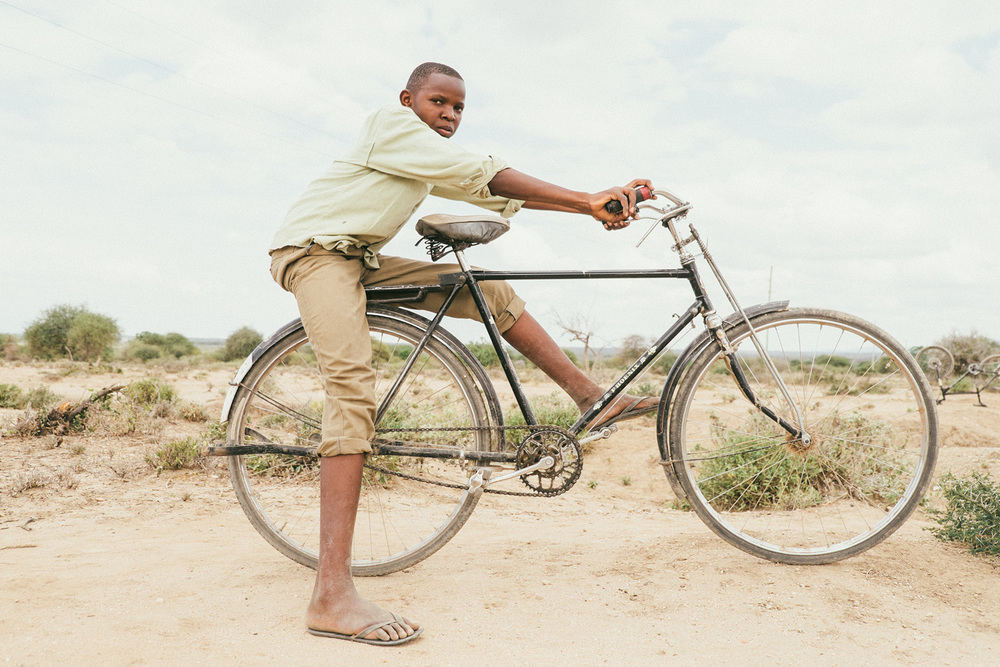 ^ This is Alvin. Alvin rides a bike that by all accounts shouldn't work in rural Tanzania, with it's lack of gears, thin road tires, no suspension, etc. To our group's surprise, Alvin blew past our group on the road, then would stop and wait for us, then blow past us again.