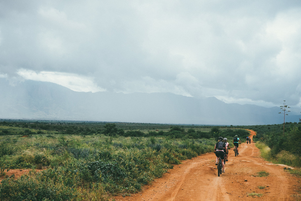 ^ The rains finally subsided and I was reunited with my cameras just in time to glimpse to first clear view of the Usambara mountains. Little did I realize that by the end of that day after riding and hiking for seemingly endless hours we would be standing on top of those very mountains.