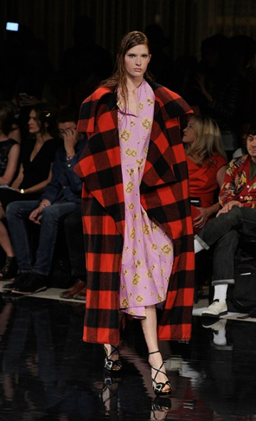Carlie Hougen's whose bodysnatcher-inspired collection won grand prize with a very strong red & black buffalo plaid blanket overcoat. (courtesty mbfashionweek.com)