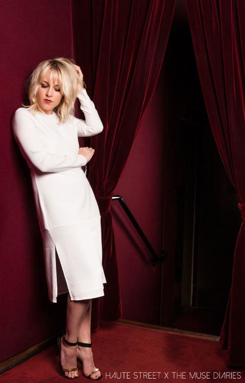 Emma Holly Jones is wearing a long sleeve dres by JENNI KAYNE, stiletto sandals by CELINE & jewelry by EFFY jewelry