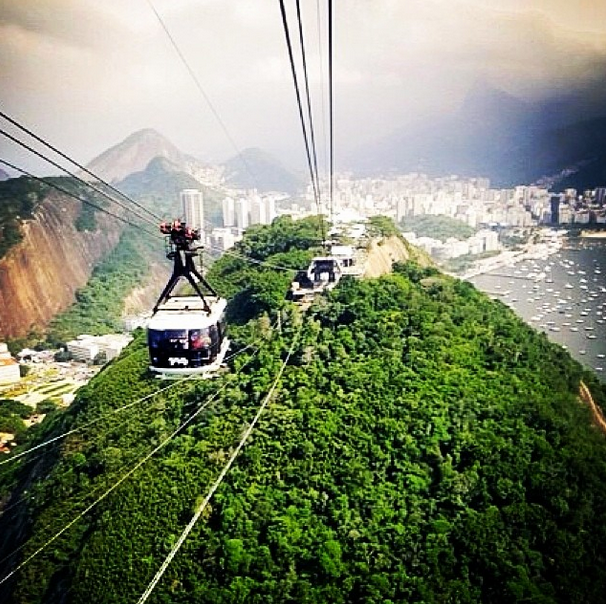 Pão de Açúcar  Known as Sugarloaf mountain here in the states, the view of Rio from the peak is absolutely spectacular. You can really go at anytime, but the sunset on a clear day is the most rewarding. Two cable cars can take you up 396m above Rio! The first ascends 220m to Morro da Urca. This stop has its own restaurant, souvenir shops, a playground, an outdoor theater and a helipad (helicopter tours are possible). The second cable car goes up to Pão de Açúcar.