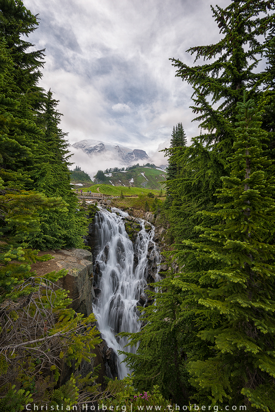 Low clouds revealing Mt. Rainier behind Myrtle Falls