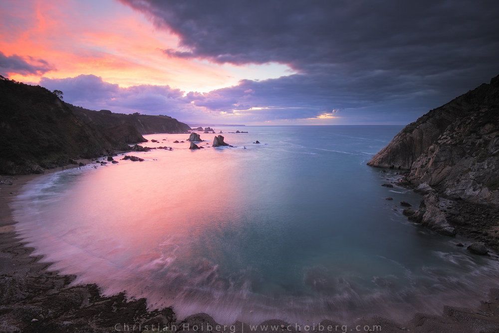 Intense sunset viewed from the cliff at Playa de Silencio