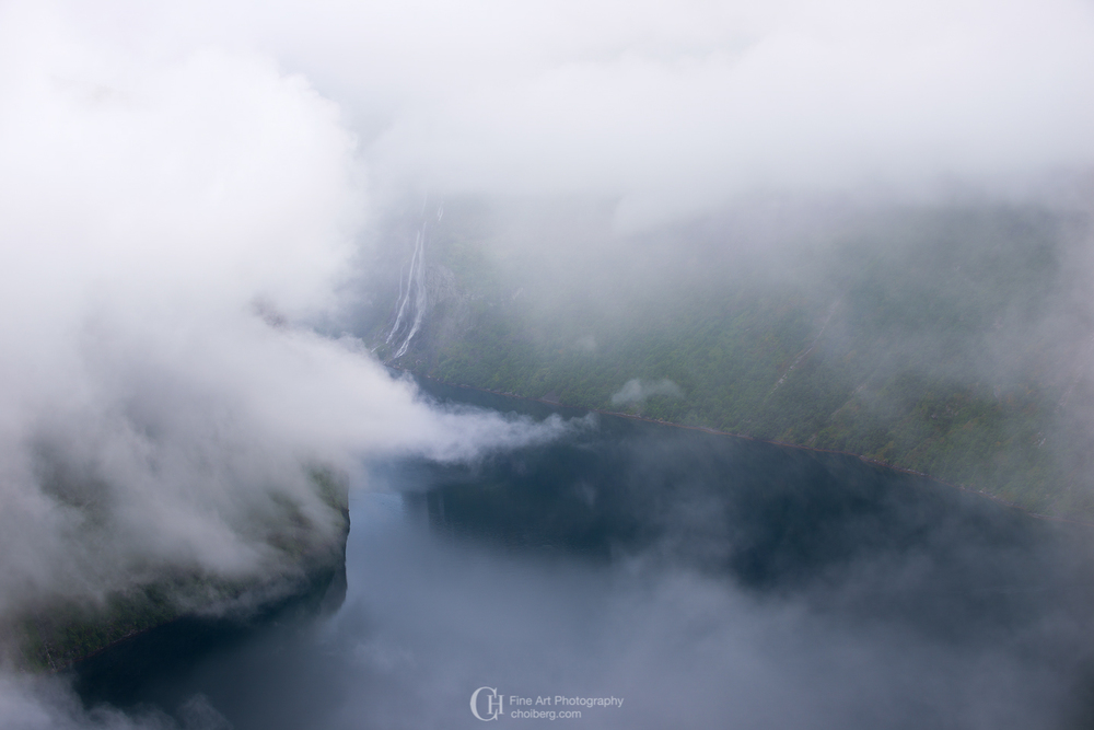 low clouds surrounding geirangerfjorden