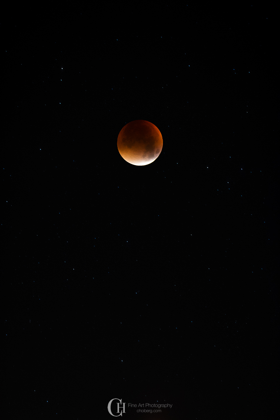Total lunar eclipse - the moon surrounded with stars