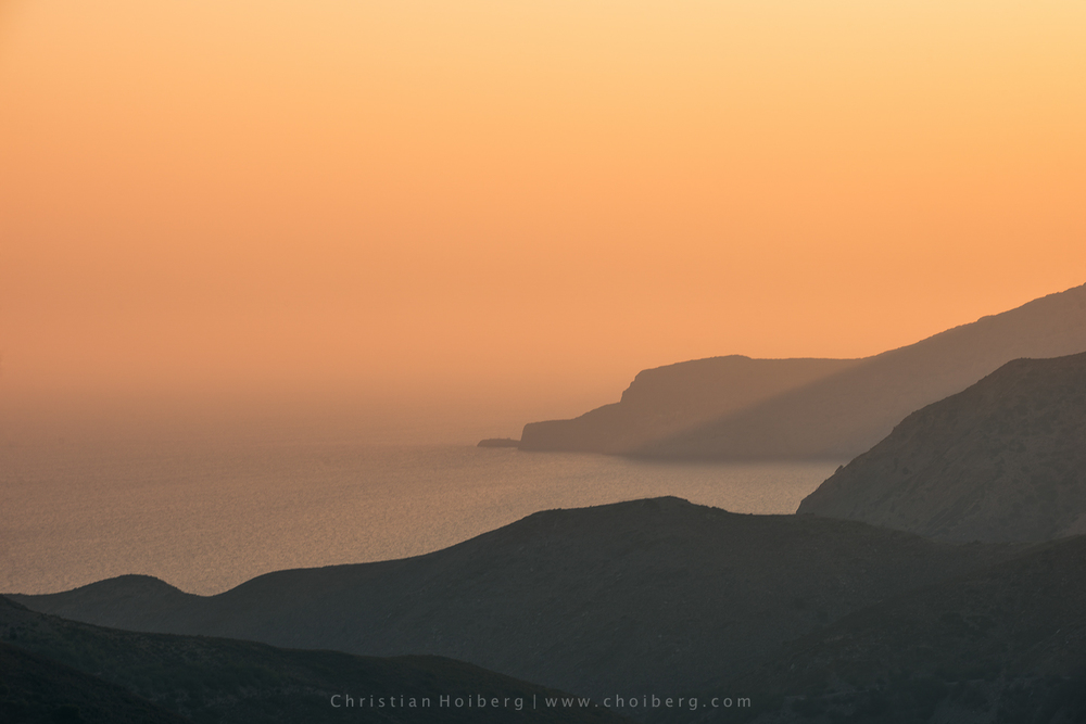 Sunrise and silhouettes of cliffs located outside of Iraklio
