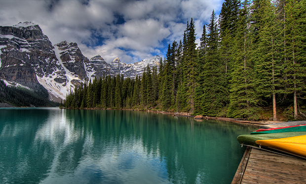 Moraine Lake with Canoes by Sandra Hotzakorgian.
