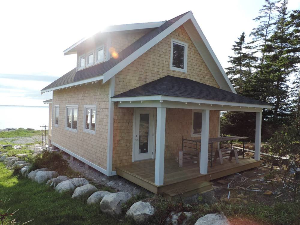 The cottage enjoys a happy view of the Atlantic Ocean and looks well hived for the coming winter!