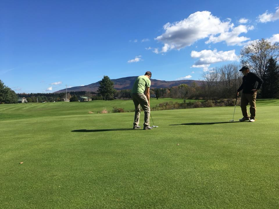 My friend learning to swing a golf club, at  Ryder Brook Golf Club.  This was a late October day in Vermont if you can believe it! Thank you to Paul, Weston's father-in-law, for the kind tutelage - I needed it - and, wow, can Paul hit a golf ball with a club with precision!